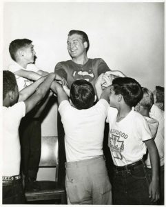 George Reeves Superman surrounded by young fans