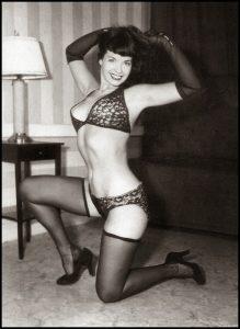 Bettie Page stockings bra sexy legs vintage photo