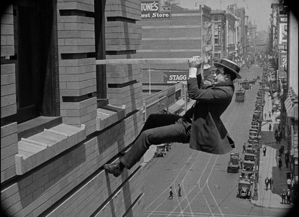 Harold Lloyd climbing building Safety Last