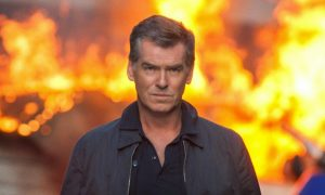 Pierce Brosnan walking away from explosion November Man