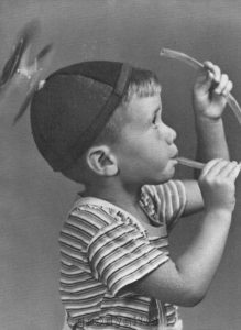 Boy wearing propeller hat