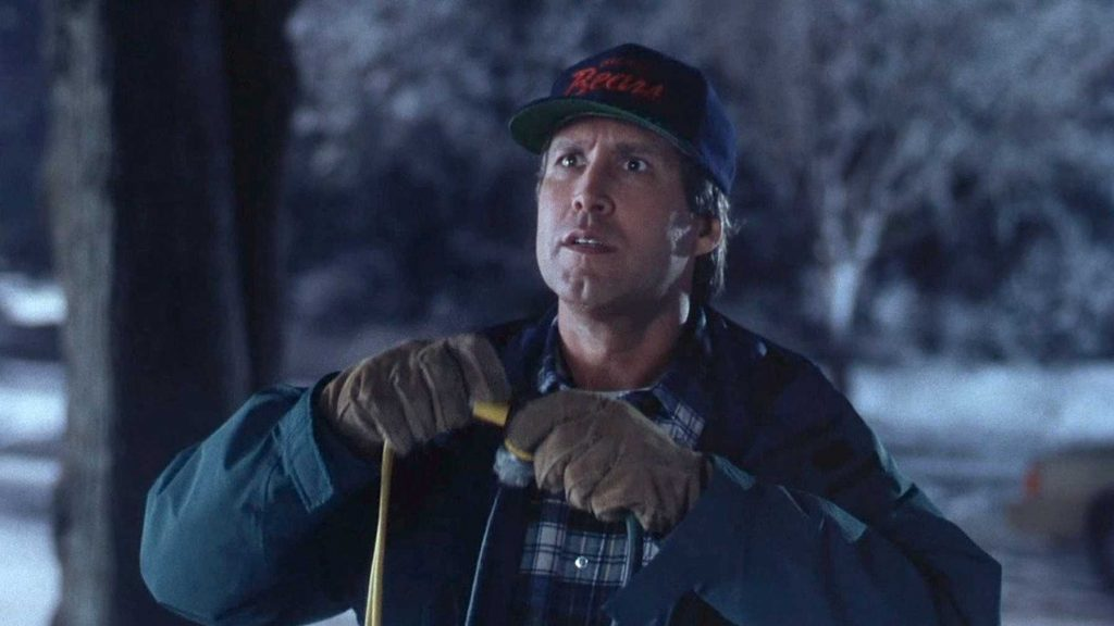 Chevy Chase National Lampoons Christmas Vacation decorating house lights scene